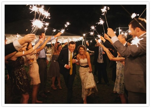 sparklers are amazing to give a party feel to the wedding and they are especially cool for NYE wedding