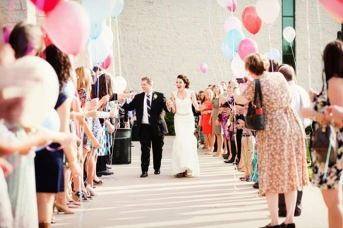 colorful balloons are a fun and cool alternative to usual wedding confetti, they will create a party feel