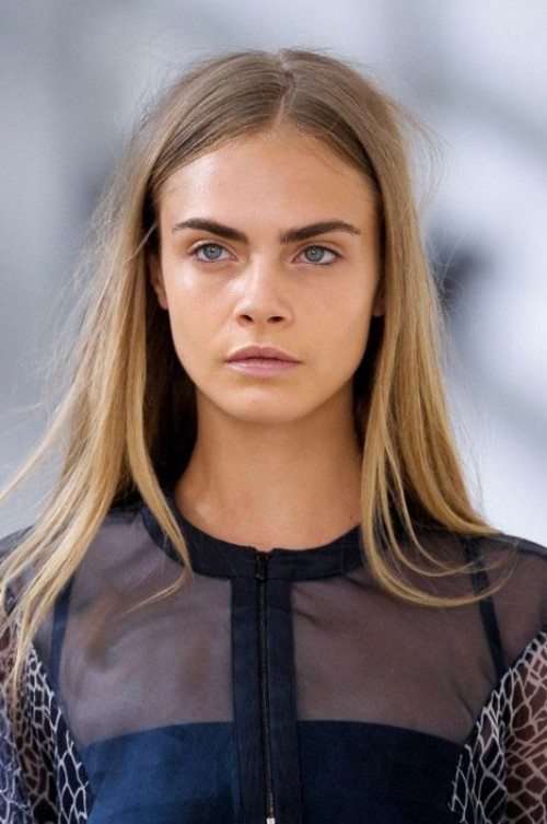 a nude makeup with a tone, a matte nude lip, statement eyebrows  and eyeliner is cool and all-natural