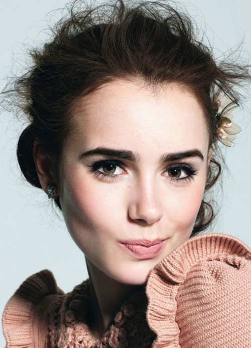 a chic nude makeup look with a tone, some pink rouge, a matte nude lip, mascara and highlighted eyebrows