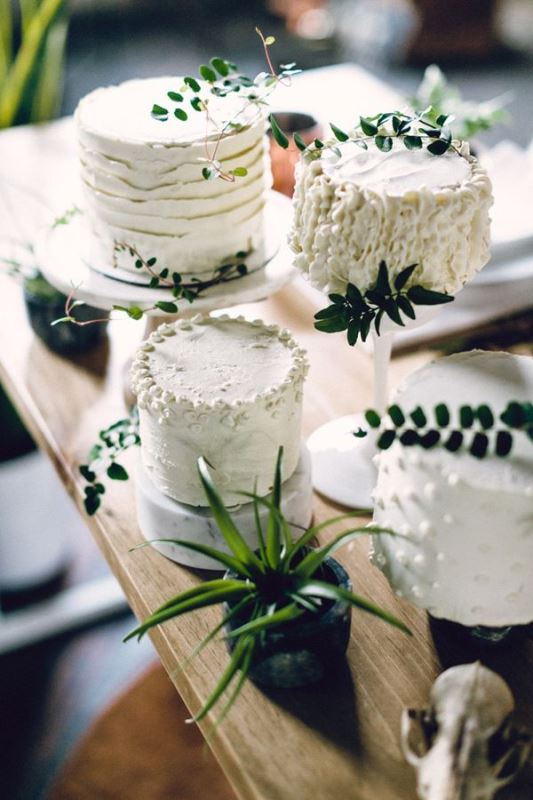 textural small white wedding cakes accented with greenery and leaves for a modern or minimalist wedding