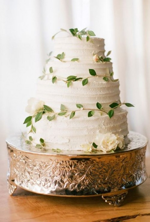 a textural white wedding cake decorated with greenery is a timeless idea for a spring or summer wedding