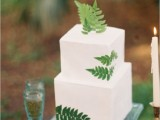 a modern woodland square wedding cake with fresh fern leaves is an amazing dessert with impeccable taste
