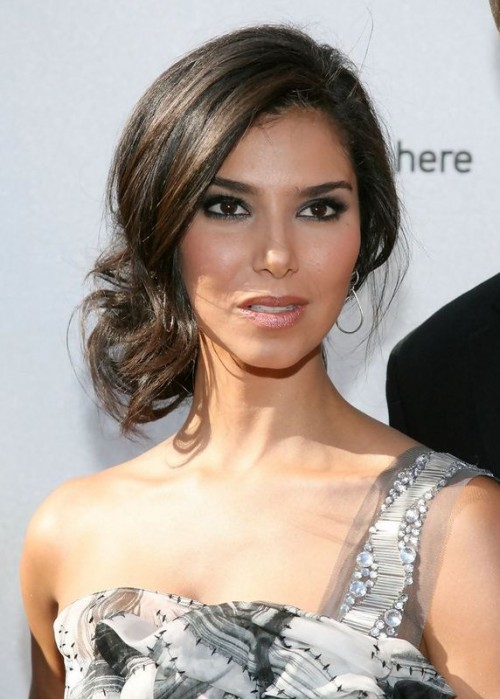 a stylish wavy and twisted side updo with a volume on top is a chic and romantic idea for a gal with medium length hair