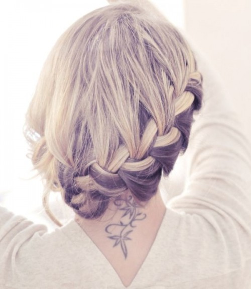 a braided halo side updo with a sleek top is a stylish and chic hairstyle that wows