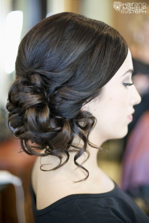 a curly side updo with a sleek top is a stylish idea for a bride who wants a bit of vintage chic