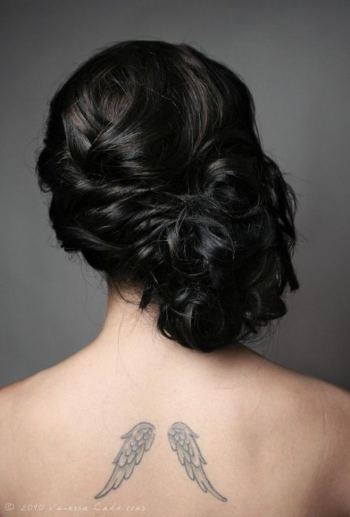 a curly twsited and wavy side updo with a volume on top for long hair and a romantic vintage bridal look