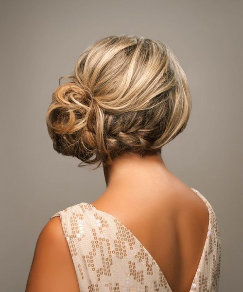 a wavy braided side bun with a textural volume on top is a chic and stylish idea for a bit of edge