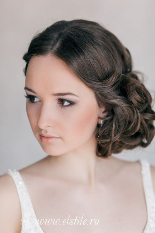 a super elegant curly side updo with a volume on top is a chic hairstyle that wows