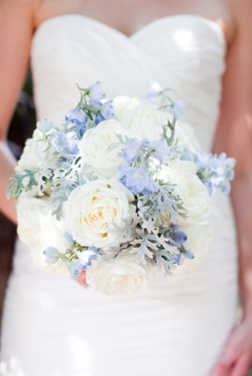 a white and powder blue wedding bouquet with a touch of greenery looks heavenly, chic and stylish