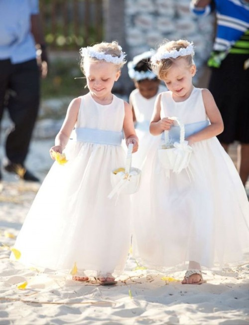 powder blue headbands and matching wide sashes to accent the flower girls' looks