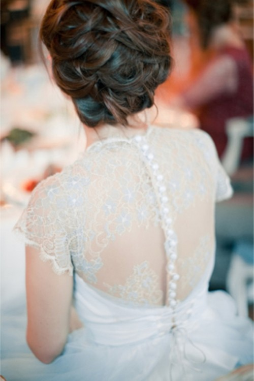 a white wedding dress with powder blue lace detailing is a chic and very sweet idea to go for