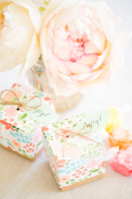 a gorgeous lush pastel bloom party centerpiece and some packed gifts