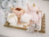 a glam vintage tea party setting with vintage porcelain and a mirror tray