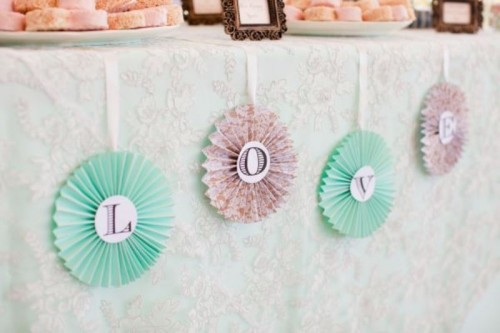 pastel-colored vintage paper fans can be used for backdrops or to decorate a dessert table