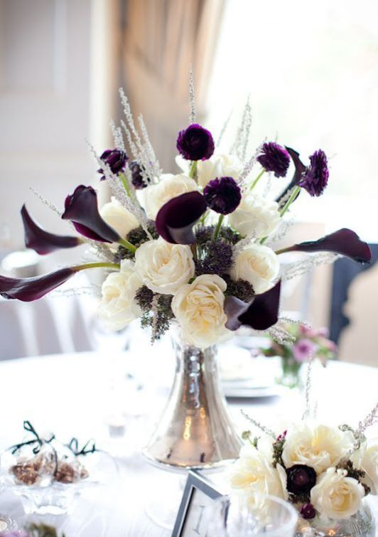 a contrasting winter wedding centerpiece of white blooms, herbs and deep purple flowers
