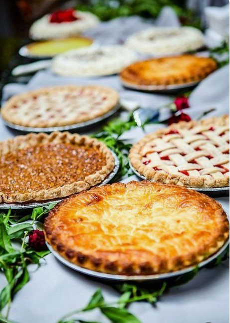 an assortment of delicious pies are a nice alternative to a usual wedding dessert table and will give a homey feel to the wedding