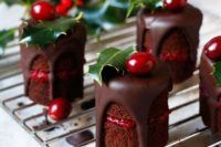 mini naked chocolate cakes with berry compote and chocolate dripping, cranberries and leaves on top are a fresh take on traditional Christmas bakes