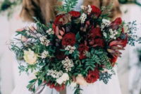 a bold red winter wedding bouquet with greenery, privet berries, greenery and white blooms