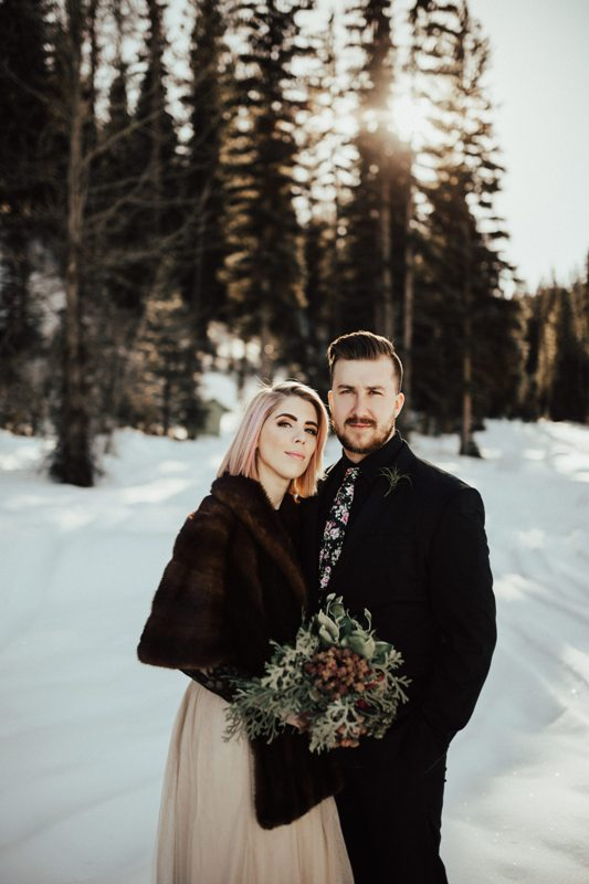 a bold winter bridal look with a tan midi skirt, a black lace top, a dark brown faux fur jacket with short sleeves is amazing