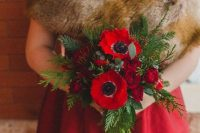 a red wedding dress is a super bold choice for a winter bride