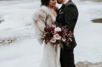 a chic and romantic lace mermaid wedding dress and a neutral faux fur cover up are amazing for a fall or winter wedding