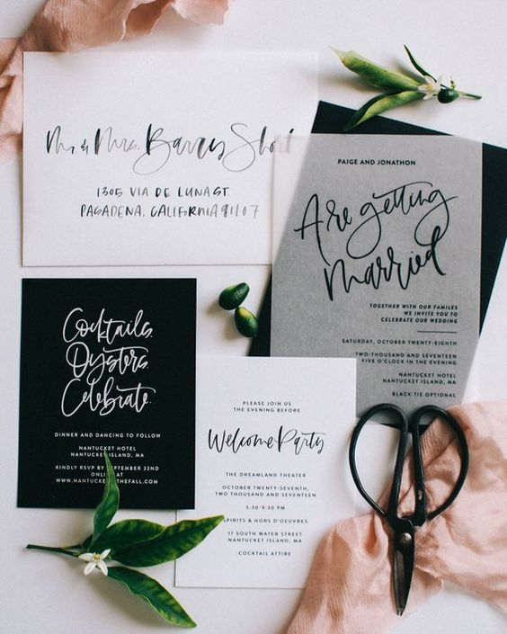 a chic black and white wedding invitation suite with calligraphy and sheer touches