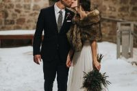 a chic bridal look with an A-line wedding dress and a brown faux fur cover up is a gorgeous idea for fall or winter