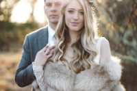 a faux fur bridal stole makes her lacy elegant style even more luxurious and refined, ideal for fall or winter