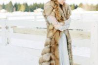 a faux fur coat is the best winter wedding accessory