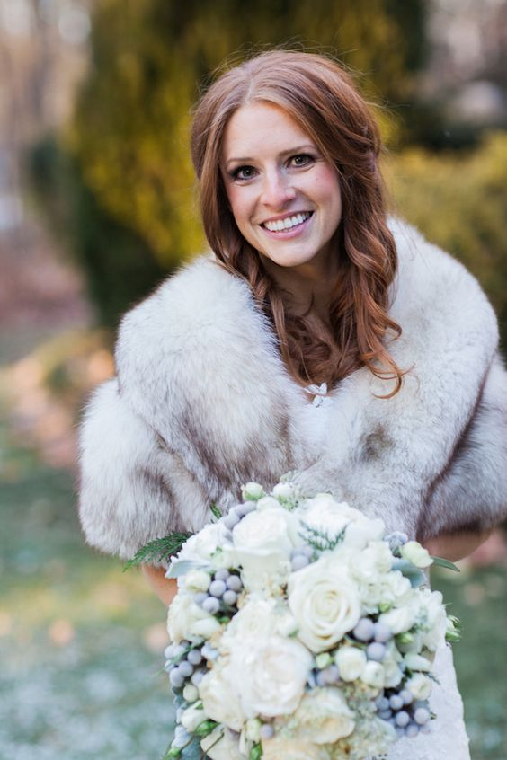 a grey faux fur stole is an elegant choice that will easily match many bridal looks, styles and color schemes of your outfit