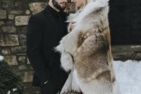 a faux fur cover up is perfect for GoT wedding