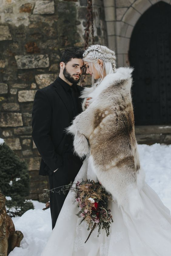 a large and rough faux fur cover up for a Game of Thrones inspired wedding is a bold statement to rock