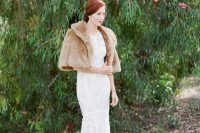 a refined and vintage-inspired winter bridal look with a lace mermaid wedding dress with a tail, a tan faux fur jacket with short sleeves