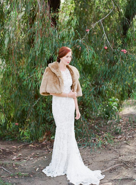 a refined and vintage inspired winter bridal look with a lace mermaid wedding dress with a tail, a tan faux fur jacket with short sleeves