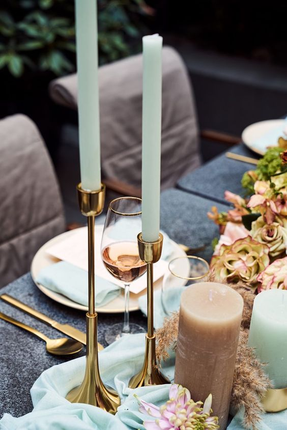 a refined wedding tablescape accented with mint napkins, a mint table runner, mint candles and a glass is very cool