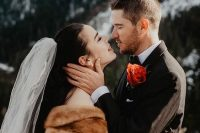 a warm beige faux fur cover up is a timeless idea for a winter bride and it will match many bridal looks