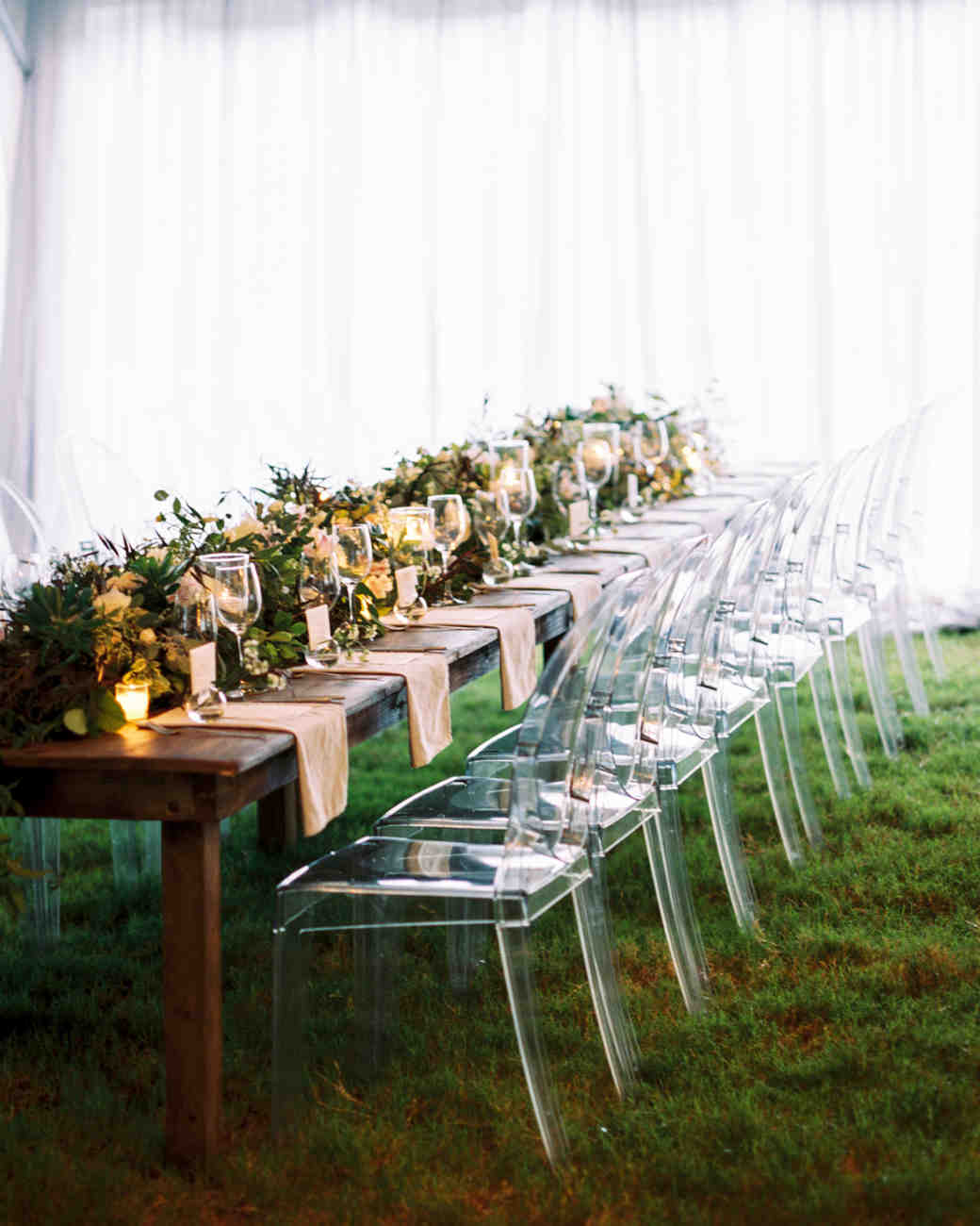 clear ghost chairs added an unexpected element to these otherwise familiar farm tables