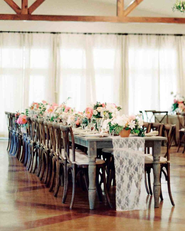lace and peachy pastels softened up the rustic weathered tables