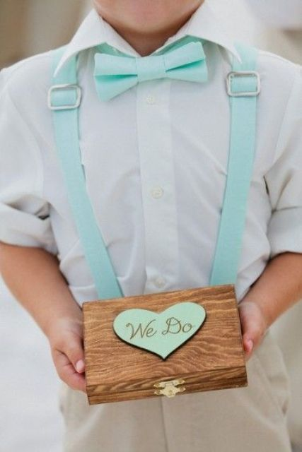 mint blue suspenders and a bow for styling a ring bearer