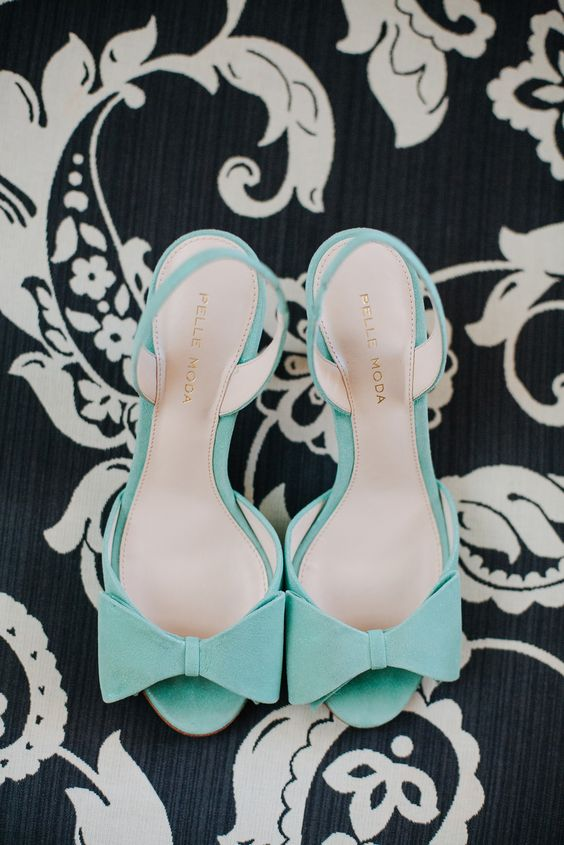 mint blue wedding shoes with large bows for a whimsy and cute bridal look
