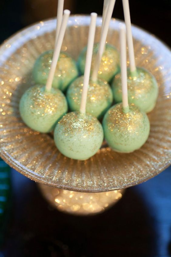 mint green cake pops with gold glitter are cool and bright and will match a mint green wedding