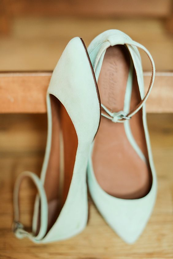 mint green flats with ankle straps are a subtle touch of color and a cool pastel look to the bridal outfit