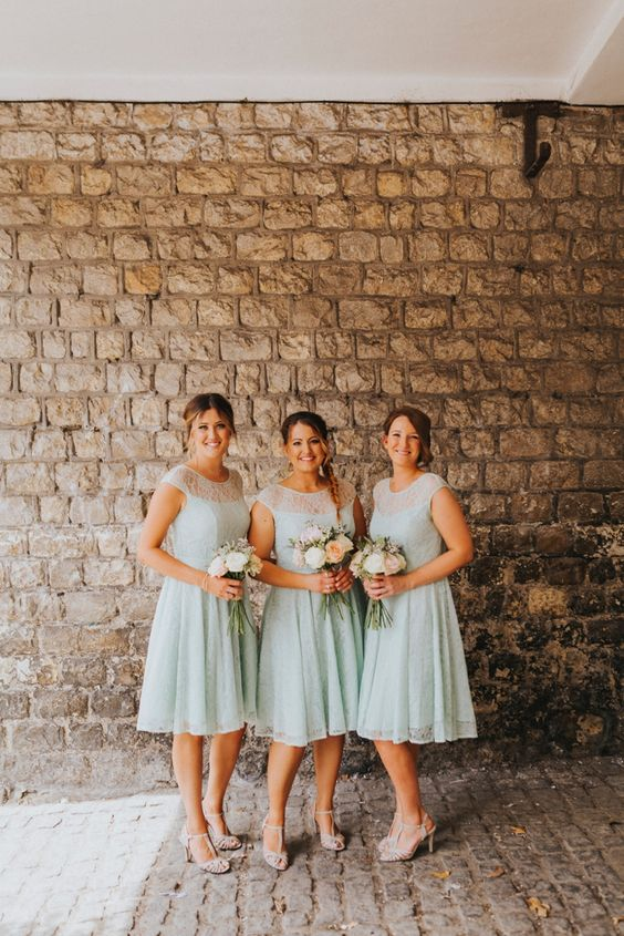 mint midi bridesmaid dresses with lace bodices, illusion necklines and white shoes