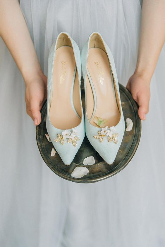 mint wedding shoes with gold and white flower detailing look whimsy and cool