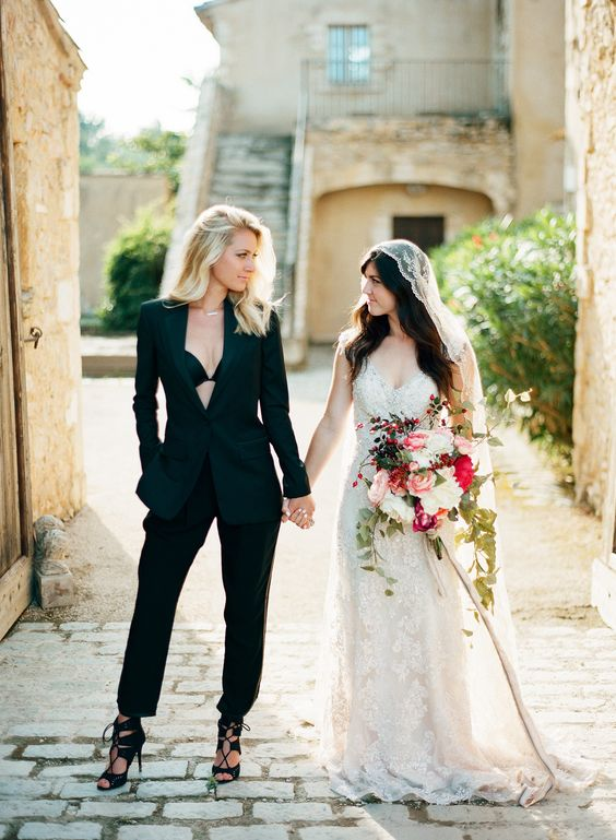 one bride rocking all black and the second bride wearing all ivory is a gorgeous idea