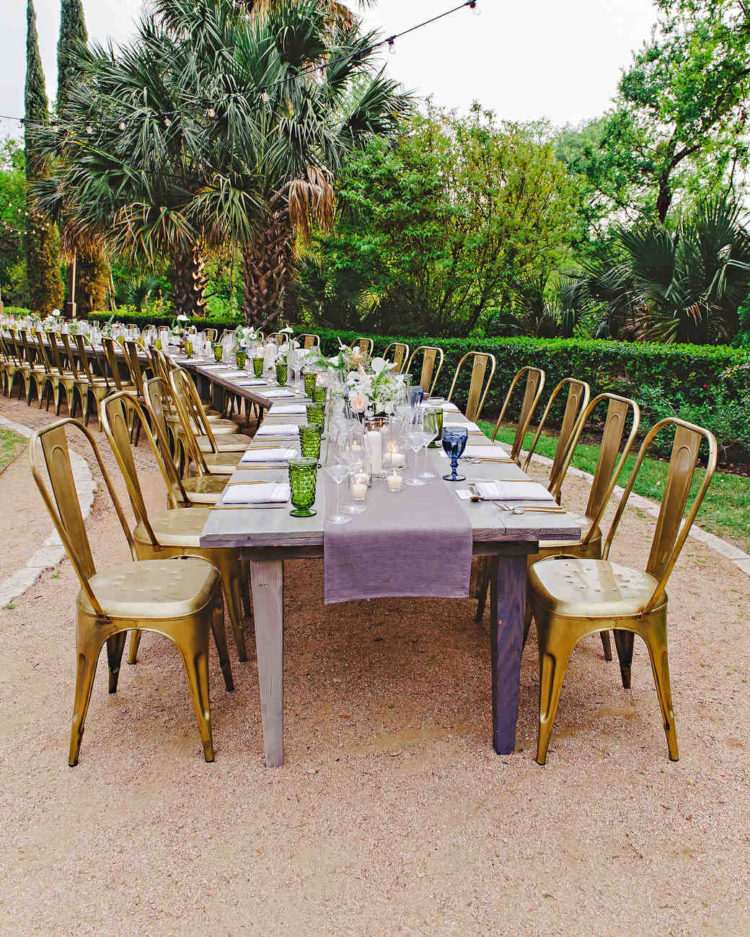 purple and gold seating plus green and blue mismatched goblets made this curving reception table