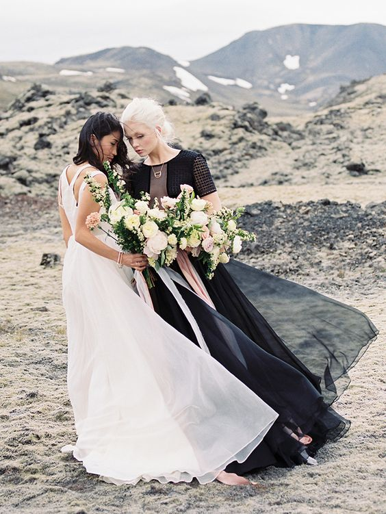 the brides wearing a black and white dress for a dramatic combo and a unique look