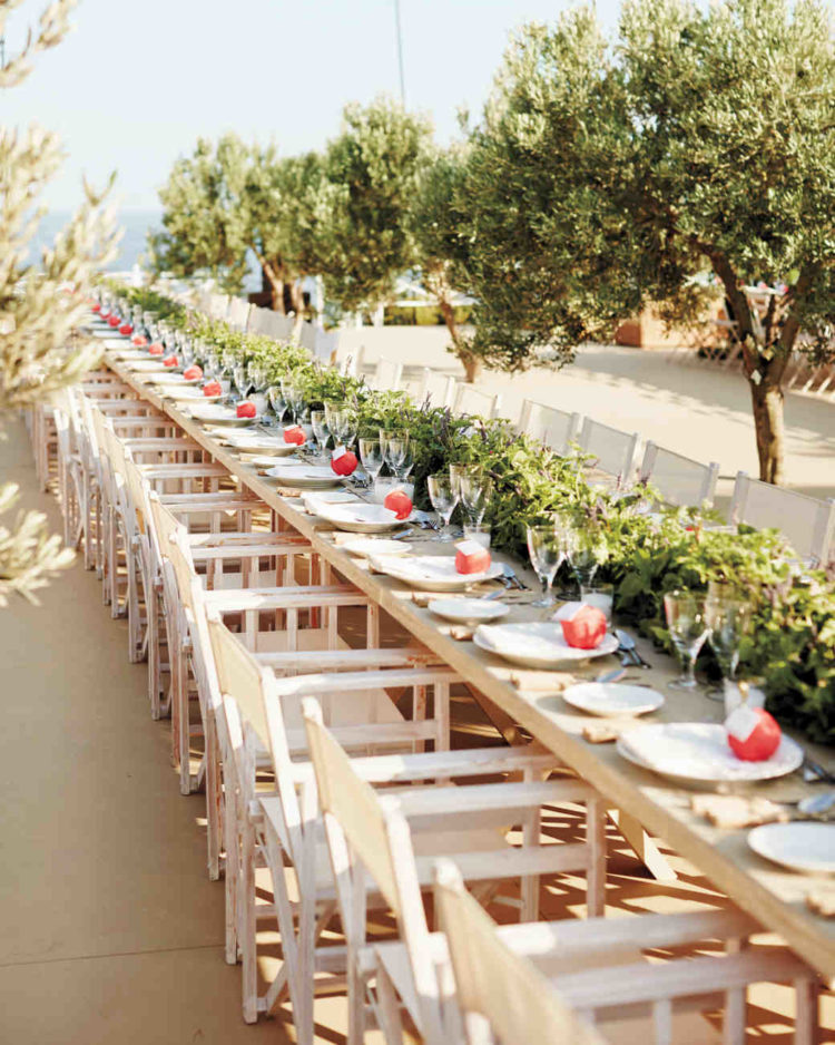 the cream-colored tables and chairs at this reception offered a clean backdrop for length-wise greenery