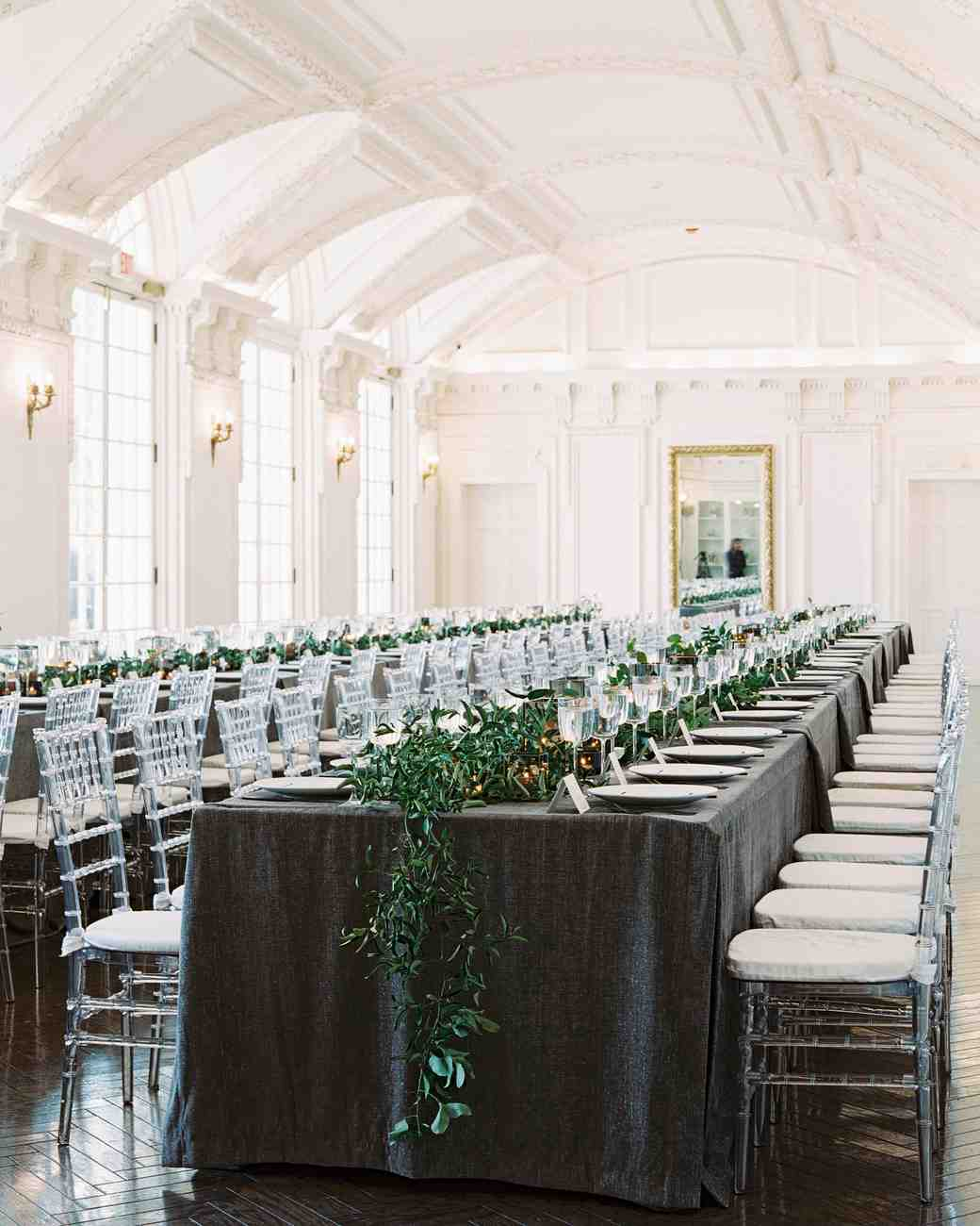 this black tie wedding pulled off banquet seating with elegant tablecloths and eucalyptus runners